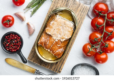 Smoked Salmon Fillets Canned fish set, on wooden cutting board, on white background with herbs and ingredients, top view flat lay