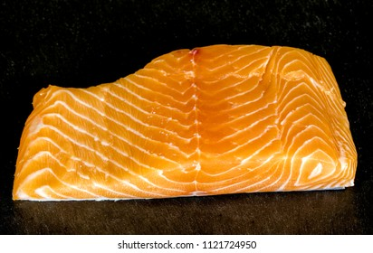 Smoked salmon fish on a slate board. Tasty smoked fillet of red fish