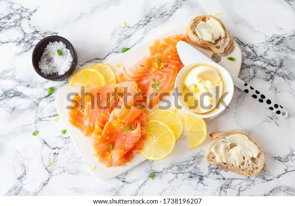 Smoked salmon with fresh lemon and baguette