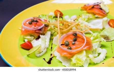 Smoked salmon with fresh salad.
