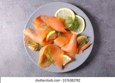 smoked salmon with lemon and dill, top view
