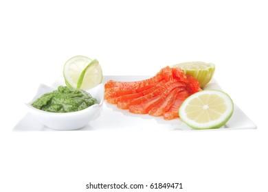 smoked salmon with lemon and hot green sauce