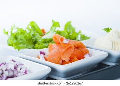 Smoked Salmon Lox platter with red onion, and cream cheese.