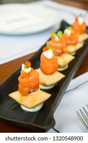 smoked salmon on crispy biscuit with truffle cream cheese