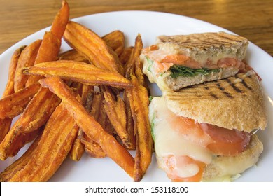 Smoked Salmon Panini Spinach Tomato Mozzarella Cheese Pesto Mayo and Sweet Potato Fries Closeup