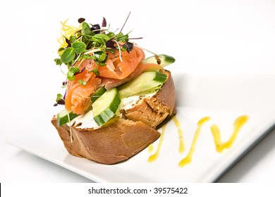 Smoked salmon and salad on cream cheese toast