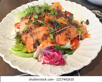 Smoked salmon salad served with tomato and vegetable in the premium restaurant