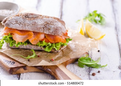 smoked salmon sandwich with cream fresh and dill on white plate