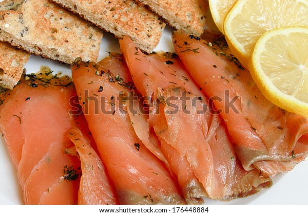 Smoked salmon sliced and arranged with toast a popular appetizer