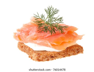 Smoked salmon and soft cheese on a piece of bread