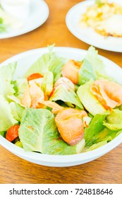 Smoked salmon with vegetable salad in white bowl - Healthy food style