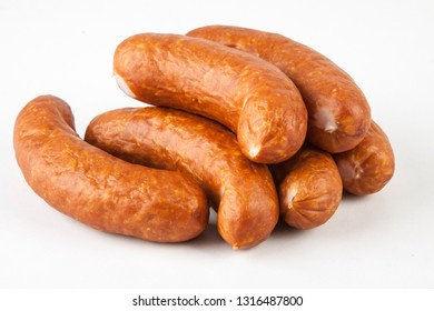 smoked sausage on the grill on white background