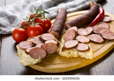 smoked sausage and spicy salami - a photo in a rustic style