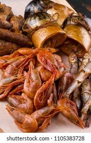smoked seafood fish and shrimp. herring, perch, capelin, mackerel home smoking. fish background closeup