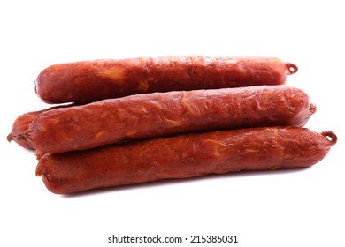 Smoked thin sausages, isolated on white