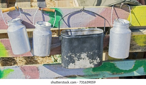 smoked tourist kettle and cans on the fence