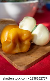 Smoked and white Fresh South Italian traditional cow or cow and sheep semi-soft cheese Scamorza ready to eat