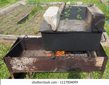 smokehouse with fish at the stake