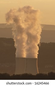 Smokes of electric / coal power plant at Sunset in Germany - Volklingen - Saarland