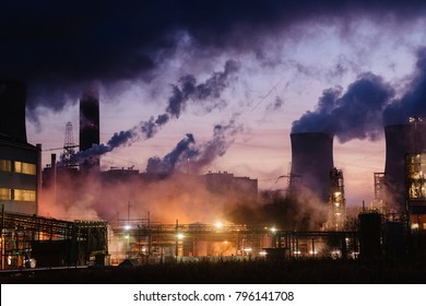 Smokes and lights of Fiddler's Ferry coal power plant in purple sunrise, Warrington, Chesihre, England