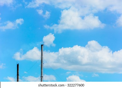 Smokestack from factory with blue sky cloud as a background