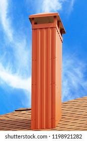smokestack on background of blue sky