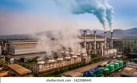Smokestack pipe factory pollution in the city, Fuel Power Plant Smokestacks Emit Carbon Dioxide Pollution, Ecosystem and healthy environment concepts and background.