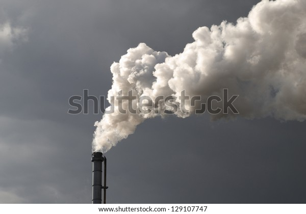 Smokestack Pollution with dark cloud in the background