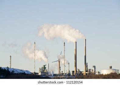Smokestacks releasing white smoke