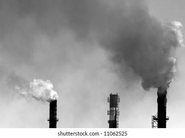 Smokestacks spewing pollution. Monochrome