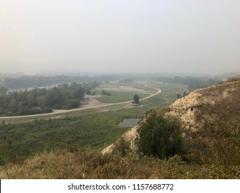 Smokey skies over Bow River Valley in Calgary, Alberta due to BC Wildfires