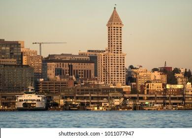 Smokey skies and sunset highlight Seattle's Smith Tower and Washington State Ferry, Kaleeten