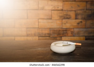 Smoking in the ashtray on a wooden background