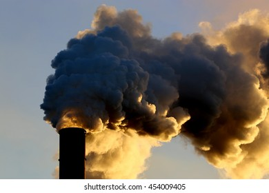 Smoking billowing mining stack ,connected mining and food  industry