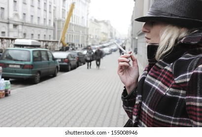 Smoking or Business lady outdoor