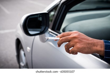 Smoking in car.