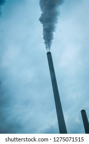 Smoking chimney carbon dioxide emission in vertical format