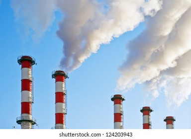 Smoking chimneys polluting the environment of the planet earth