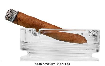 Smoking cigar in an ashtray