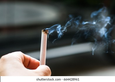 Smoking cigarette in the hands