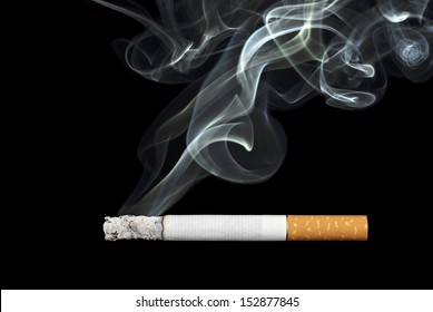 smoking cigarette on black background