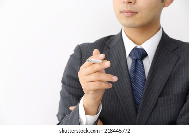 Smoking cigarette in silhouette studio isolated on white background