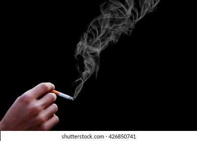 smoking cigarette with smoke in a black backgrounds. world no tobacco days concept.