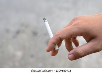 Smoking cigarettes Harmful to health