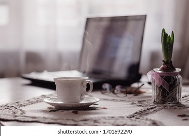 Smoking coffee on table with laptop