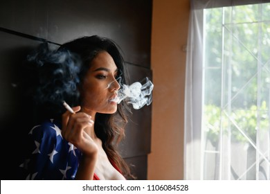 Smoking concept. Sexy women are smoking in the room. Sexy women are relaxing by smoking. Beautiful women have seductive charm.