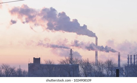 Smoking factory chimneys. Environmental problem of pollution of environment and air in large cities. View of large plant with Smoking pipes. Timelapse