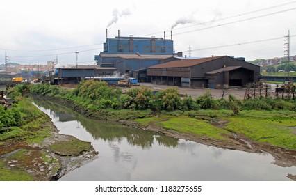smoking factory in outskirt of Santander city, Spain