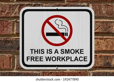 Smoking Free Workplace Sign, An red and white sign with cigarette icon and not symbol with text on a brick wall
