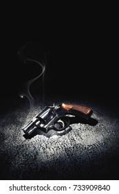 Smoking gun on the floor / high contrast image